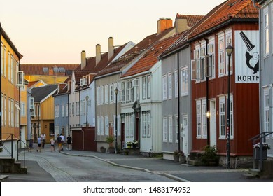 Trondheim, Norway 07/28/2019 narrow street in the residential district Bakklandet in the Norwegian city Trondheim during sunset