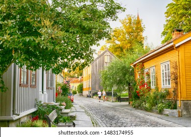 Trondheim, Norway 07/28/2019 :The street at Bakklandet , popular residential district with old timber houses in the Norwegian city trondheim