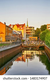 Trondheim, Norway 07/28/2019 The view of the cafe Loekka in the Norwegian city Trondheim during sunset in the summer