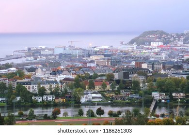 Trondheim, Norway - 09/22/2018 :Foggy rainy twilight in the Norwegian city trondheim, view of the Trondheim fjord, harbour, river Nidelva and historical center