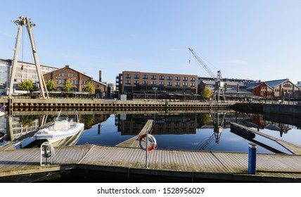 Trondheim, Norway 10/09/2019 Fall in Trondheim, shopping mall Solsiden reflecting in the water