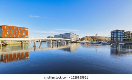 Trondheim, Norway 10/09/2019 River Nidelva, Flower Bridge, hotel Scandic Nidelven , shopping mall Solsiden and residential district in the Norwegian city trondheim