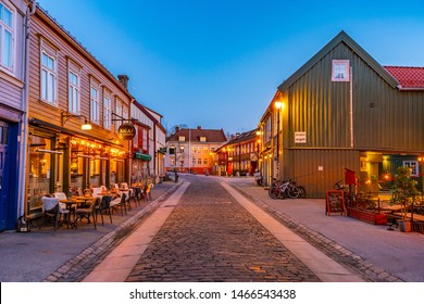 TRONDHEIM, NORWAY, APRIL 15, 2019: Sunset view of a narrow street in the Brygge district of Trondheim, Norway