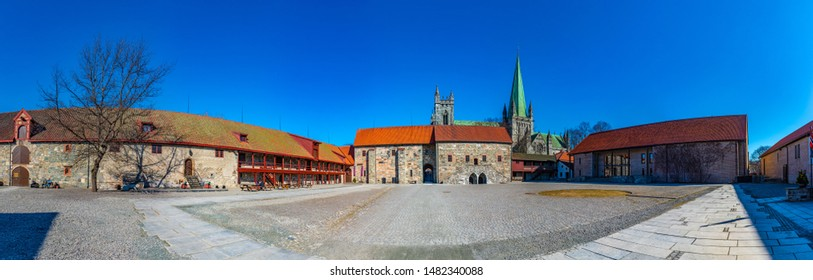TRONDHEIM, NORWAY, APRIL 16, 2019: Nidaros cathedral viewed from courtyard of archbishop's palace in Trondheim, Norway