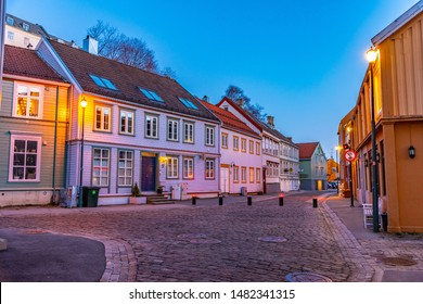 TRONDHEIM, NORWAY, APRIL 16, 2019: Sunset view of a narrow street in the Brygge district of Trondheim, Norway