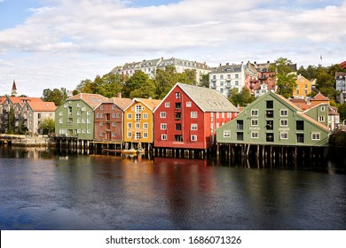 Trondheim, Norway- Aug 28, 2018: Cityscape of Trondheim, the famous colorful old timber houses by the Nidelva river in central Trondheim, Norway.
