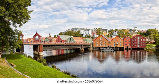 Trondheim, Norway- Aug 28, 2018: Old town bridge over Nidelva river with the main landmarks attraction in Trondheim, Norway, the famous colored wooden houses.