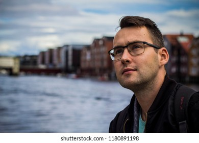 Trondheim, Norway - August, 2018: Local man in Trondheim city with the  colorful houses at the background