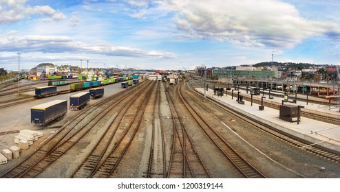 Trondheim, Norway - August 29th, 2018: Panorama view of the railways and shipping containers of the Trondheim Central Train Station, Norway.