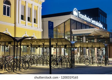 Trondheim, Norway - August 29th, 2018: View of the bikes parked next to the main entrance of the Trondheim Central Train Station in Norway.