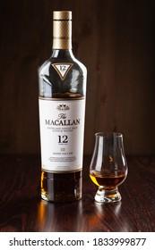 Trondheim, Norway - Mai 19 2020: Macallan single malt scotch whisky 12 years bottle and glass