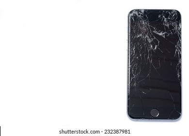 Trondheim, Norway - November 19, 2014: Photo of a iPhone 6 with broken display. Isolated on white with copy space.