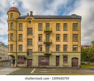 TRONDHEIM, NORWAY - SEPTEMBER 07, 2019: The main street facade of a derelict building that has obviously seen better days.