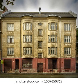 TRONDHEIM, NORWAY - SEPTEMBER 07, 2019: The front facade of a derelict art deco building that has obviously seen better days.
