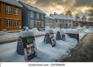 Trondheim, Sor-Trondelag / Norway - 01 23 2019:Baklandet street under snow. Wintertime in Trondheim, Norway. Colorful town buildings, original old town look.