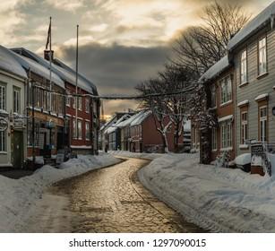 Trondheim, Sor-Trondelag / Norway - 01 23 2019: Baklandet street under snow. Wintertime in Trondheim, Norway. Colorful town buildings, original old town look.