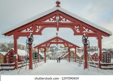 Trondheim, Sor-Trondelag / Norway - 01 23 2019: Old bridge called Gamle Bybro connecting old town Baklandet  with city center. Trondheim in Norway, beautiful winter scenery.
