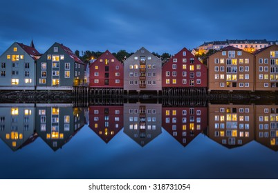 Trondheim, Trondelag, Norway. The old city of Trondheim and Nidelva River at evening.