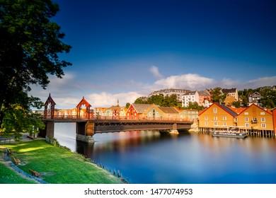 "Trondheim, Trondelag/Norway - 04 11 2019: "" Den gamle bybro "" in the sun. Photo over Nidelva in Trondheim, Norway. Famous tourist attraction in Trondheim"