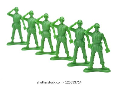 Troops of in lined military on a salute gesture against white background