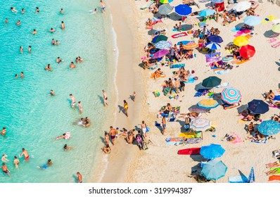 TROPEA, CALABRIA, ITALY, 06 August, 2015:Drone view of Tropea beach, Calabria. Panoramic view of beach with umbrellas top view.The town is a famous bathing place with turquoise water and white sand.