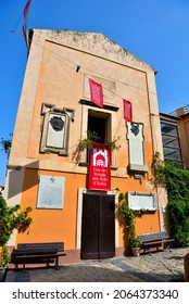 TROPEA, ITALY 16 SEPTEMBER ancient building in the historic center with red banner in Italian: one of the most beautiful villages in Italy16 September 2021 Tropea  Italy