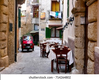Tropea, Italy - august 17: Red Piaggio Ape 50 in a picturesque alley of Tropea.