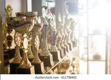 Trophy award for the winner show on shelf.