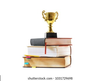 trophy and book with pencil on white background