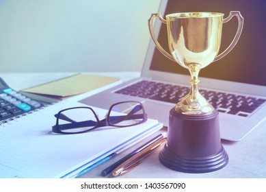 Trophy decorate on working table,acheive concept.
