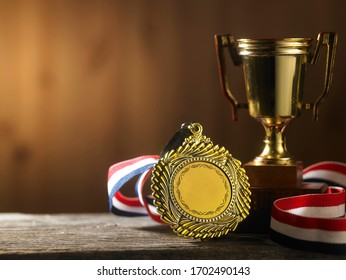 trophy with ribbon on the brown woden background