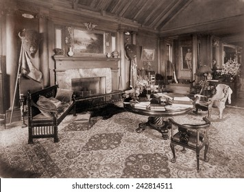 Trophy room at Sagamore Hill, summer home of President Theodore Roosevelt, with bison heads, bearskin rug, and battle standards. Ca. 1910.