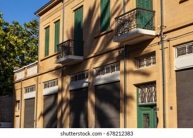 Tropic palm tree shadow on generic mediterranean architecture street house