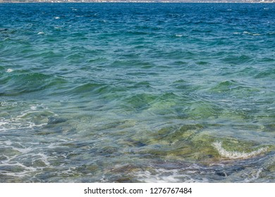 tropic sea shoreline with waves vivid blue color surface and shallow bottom background wallpaper landscape pattern