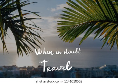 Tropic travel card with handwritten phrase. When in doubt. Travel.