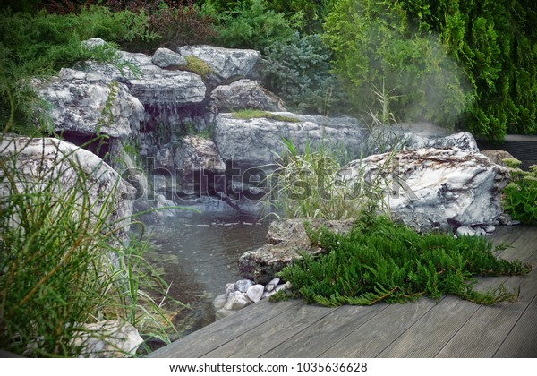 Tropical Artificial Pond Brook Waterfall Decorative Stock Photo