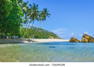 Tropical background - secret beach in Mirissa, Sri Lanka