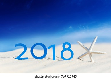 tropical beach and 2018 happy new year. Season vacation, holiday concept