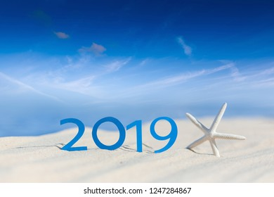 tropical beach and 2019 happy new year. Season vacation, holiday concept