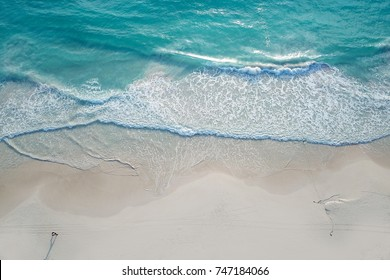Tropical Beach aerial with one person walking along the coast