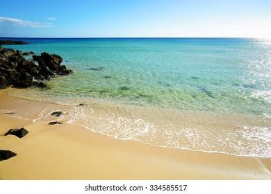 Tropical beach, azure ocean water and blue sky. Paradise landscape