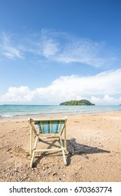 tropical beach background  with beach chair on sand with beautiful blue sea and cloudy sky,Image for summer fun party travel concept.