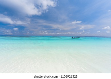 Tropical beach background. Horizon with blue sky and white sand. Tachai island Phang nga Thailand - Shutterstock ID 1106926328