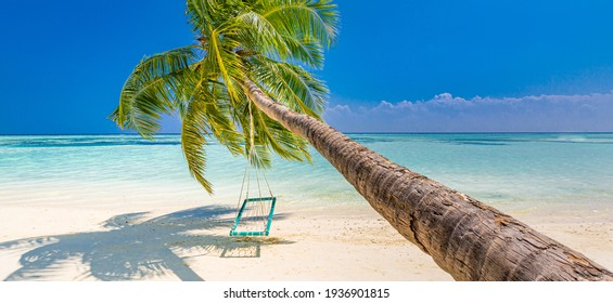 Tropical beach background as summer landscape with beach swing or hammock and white sand and calm sea for beach banner. Perfect beach scene vacation and summer holiday. Relax, carefree, freedom nature