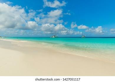 Tropical beach background with white sand beach and soft blur sea