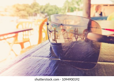 Tropical beach bar reflected in sunglasses, exotic holiday background