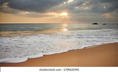 Tropical beach at beautiful sunset, Sri Lanka.