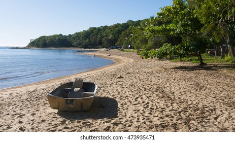 Tropical beach with boat in foreground