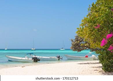 Tropical beach with boats, archipelago Los Roques, Venezuela