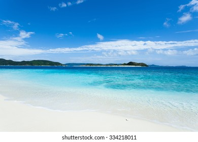 Tropical beach with clear blue water and white sand on a deserted coral island, Kerama Islands National Park, Okinawa, Japan